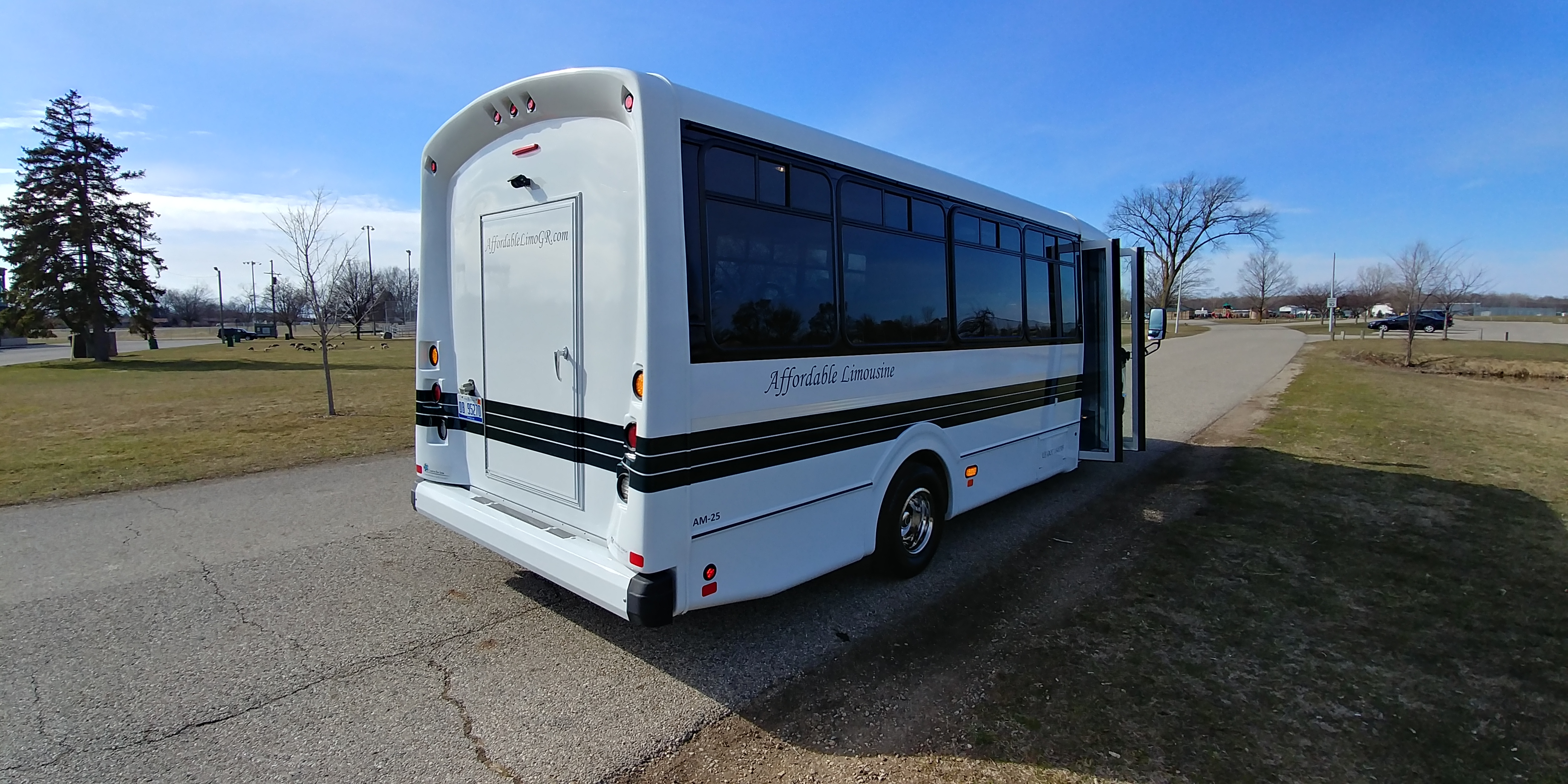 24 Passenger Executive Shuttle Bus Passenger's Side Rear