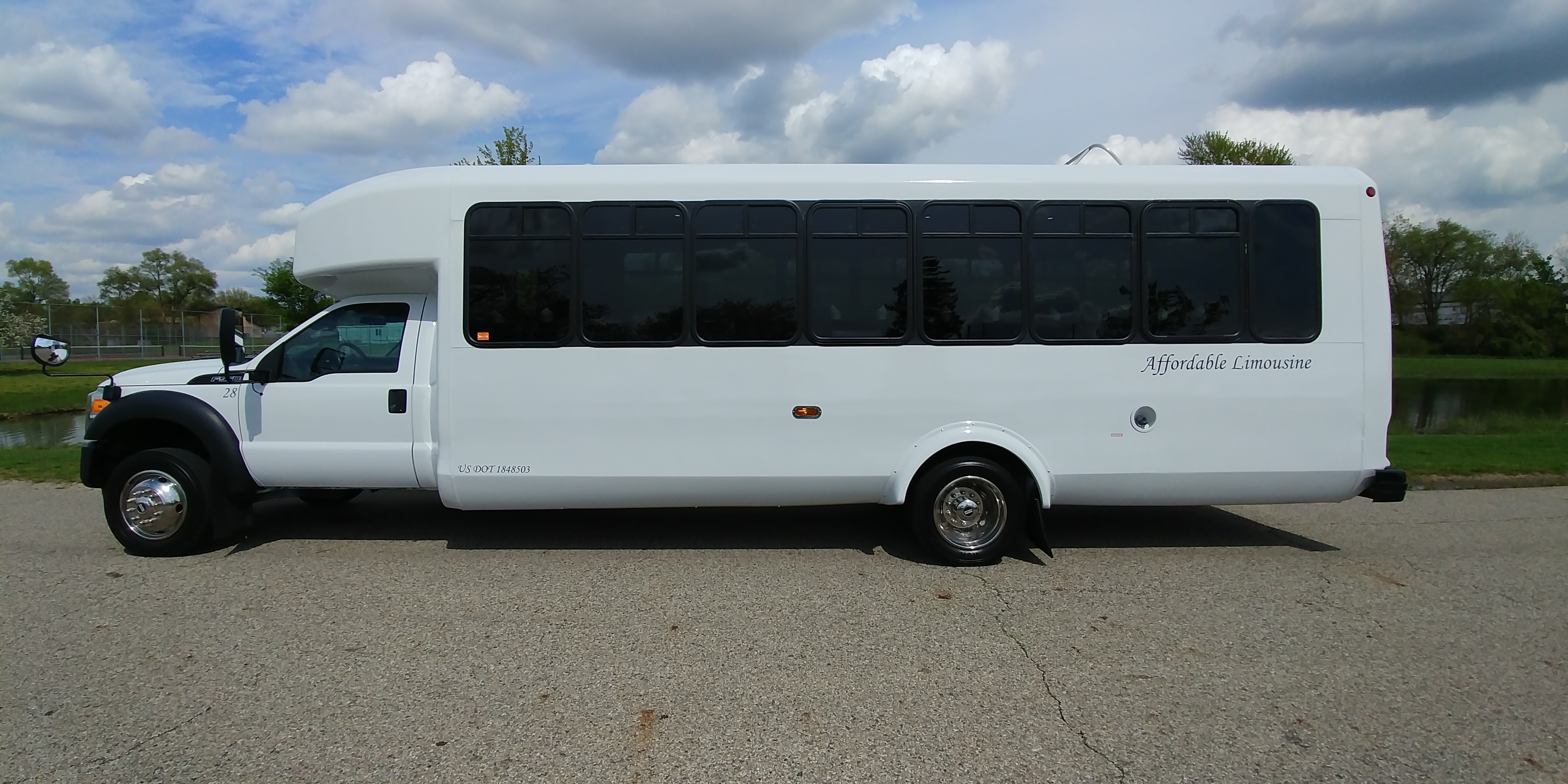 28 Passenger Luxury Limo Bus Driver's Side