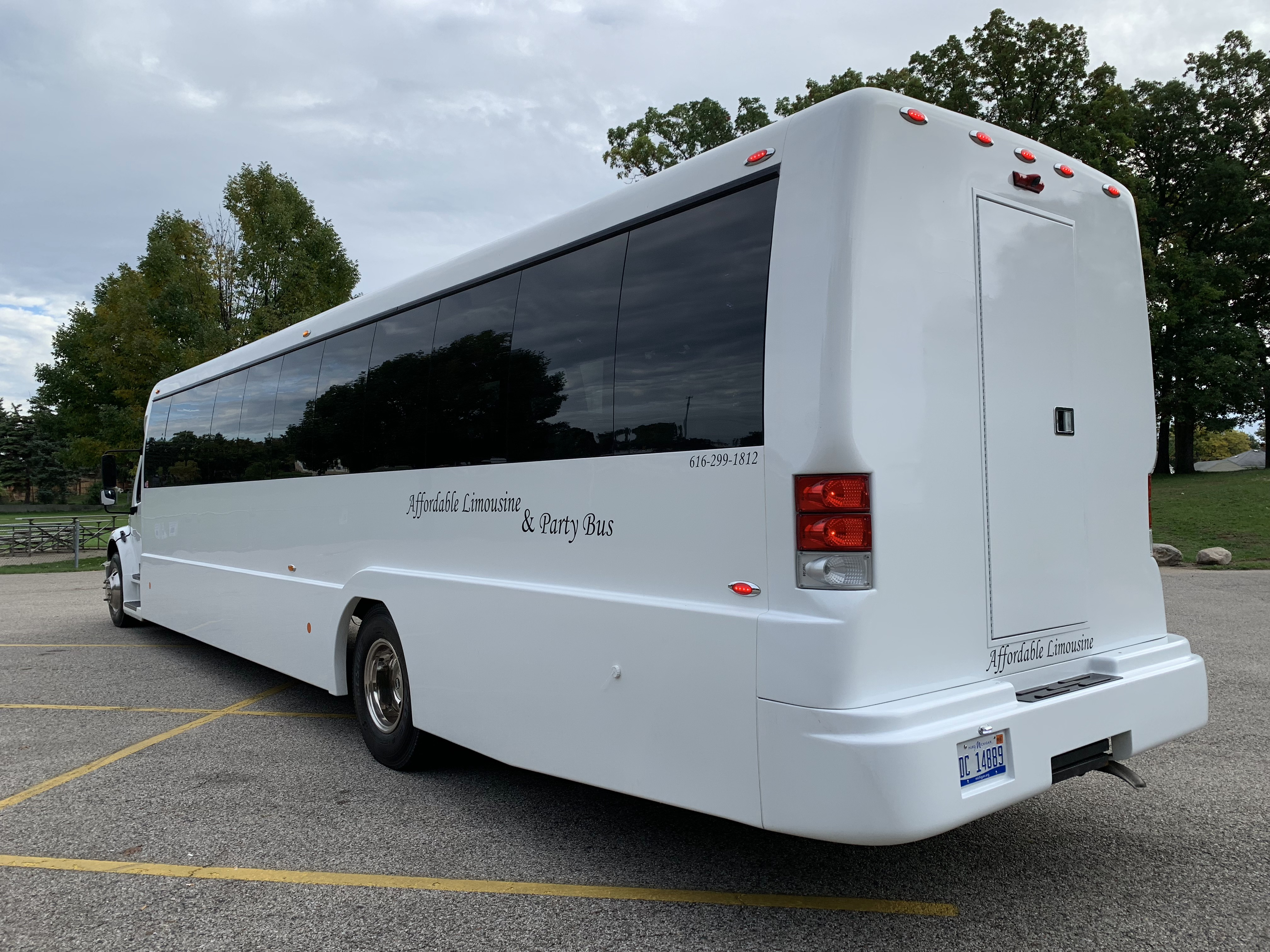 45 Passenger Luxury Limo Coach Driver's Side Rear