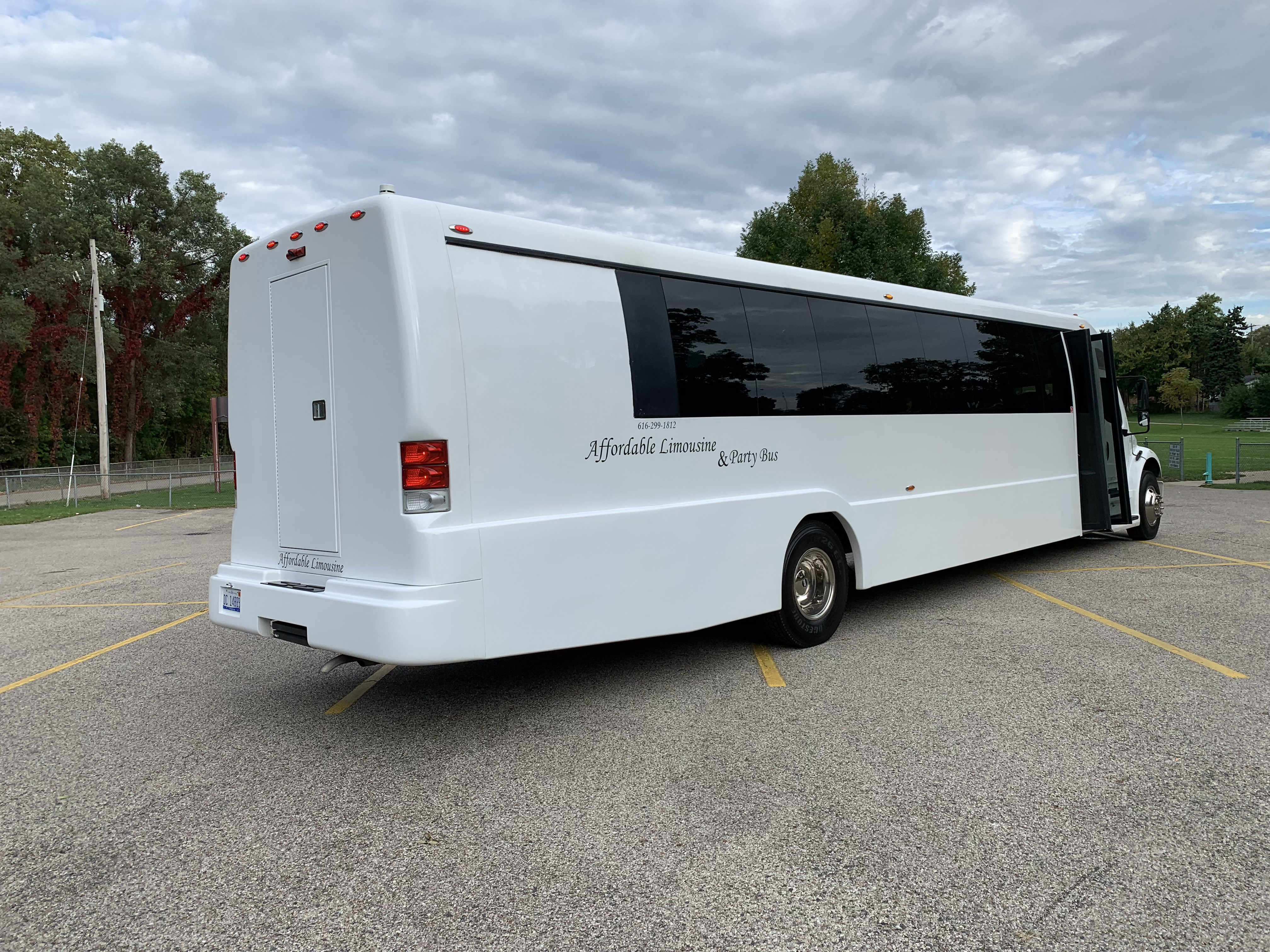 45 Passenger Luxury Limo Coach Passenger's Side Rear